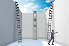 The businessman climbing a ladder to escape from problems Stock Photos