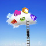 Businessman climbing ladder up cloud with app blocks Stock Photo