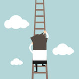 Businessman climbing the ladder Royalty Free Stock Photography