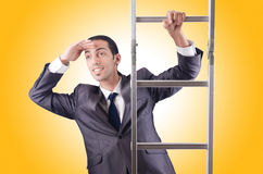 Businessman climbing the ladder  Stock Photos