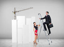 Businessman climbing a ladder. Businessman with women assistant climbing a ladder with motivation background royalty free stock photos