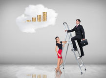Businessman climbing a ladder Royalty Free Stock Photos