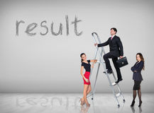 Businessman climbing a ladder. Businessman with women assistant climbing a ladder with motivation background royalty free stock image