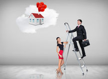 Businessman climbing a ladder. Businessman with women assistant climbing a ladder with motivation background stock photo