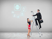 Businessman climbing a ladder. Businessman with women assistant climbing a ladder with motivation background stock image
