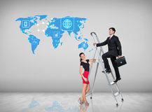 Businessman climbing a ladder. Businessman with women assistant climbing a ladder with motivation background. Elements of this image furnished by NASA Stock Image