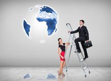 Businessman climbing a ladder. Businessman with women assistant climbing a ladder with motivation background. Elements of this image furnished by NASA Royalty Free Stock Photo