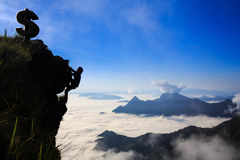 Businessman climbing a mountain. Business success concept stock images