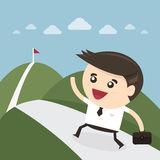 Businessman climbing on the mountain Royalty Free Stock Photography