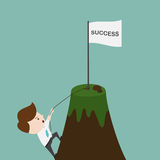 Businessman climbing on the mountain. Royalty Free Stock Photography