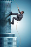 The businessman climbing skyscraper in challenge concept. Businessman climbing skyscraper in challenge concept Royalty Free Stock Photos