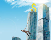 Businessman climbing skyscraper Royalty Free Stock Images