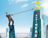 Businessman climbing skyscraper with word business Royalty Free Stock Images