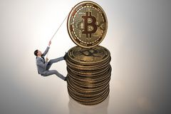 The businessman climbing the stack of bitcoins. Businessman climbing the stack of bitcoins Stock Photos