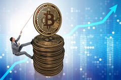 The businessman climbing the stack of bitcoins. Businessman climbing the stack of bitcoins Stock Photo