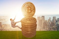 The businessman climbing the stack of bitcoins. Businessman climbing the stack of bitcoins Stock Photography