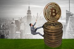 The businessman climbing the stack of bitcoins. Businessman climbing the stack of bitcoins Stock Images