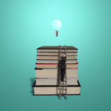 Businessman climbing on stack of books with ladder and bulb Stock Photo