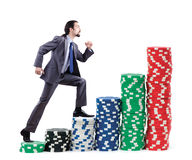 Businessman climbing stacks of  chips Royalty Free Stock Photography