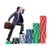 Businessman climbing stacks of  chips Stock Images