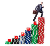 Businessman climbing stacks of  chips Stock Photography