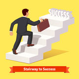 Businessman climbing the staircase of success Royalty Free Stock Image