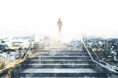Success and growth concept. Businessman climbing stairs on abstract city background with sunlight. Success and growth concept. Double exposure royalty free stock images