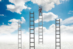 The businessman climbing stairs against the sky Stock Photography