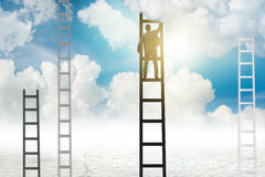 The businessman climbing stairs against the sky Royalty Free Stock Images