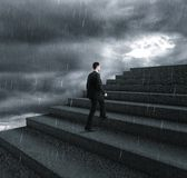 Businessman climbing stairs Royalty Free Stock Images