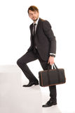Businessman climbing stairs with a briefcase Royalty Free Stock Photography