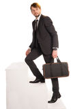 Businessman climbing stairs with a briefcase Stock Photo