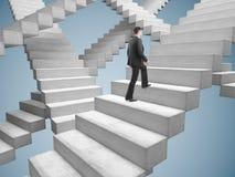 Businessman climbing stairs Stock Image