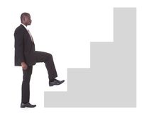 Businessman climbing steps Royalty Free Stock Photos