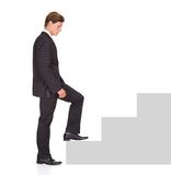 Businessman Climbing Steps Royalty Free Stock Photography