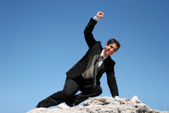 Businessman climbing for success Stock Images