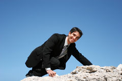 Businessman climbing for success Royalty Free Stock Image