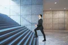 Businessman climbing success stairs side Stock Images