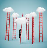 Businessman climbing to cloud Royalty Free Stock Image