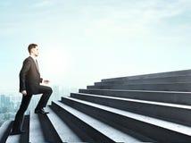 Businessman climbing Stock Images
