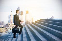 Businessman climbing to success royalty free stock image