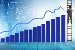 The businessman climbing towards growth in statistics. Businessman climbing towards growth in statistics Royalty Free Stock Photos