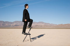 Businessman climbing up Royalty Free Stock Photos