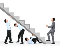 Businessman climbing up Stock Photos