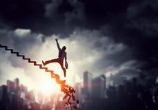 Businessman climbing up the career ladder Stock Photo
