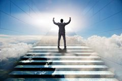 Businessman climbing up challenging career ladder in business co Royalty Free Stock Images
