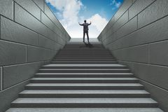 Businessman climbing up challenging career ladder in business co Royalty Free Stock Photos