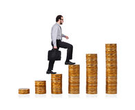 Businessman climbing up Stock Photography