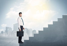 Businessman climbing up a concrete staircase concept Royalty Free Stock Photo