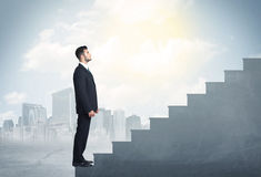 Businessman climbing up a concrete staircase concept Royalty Free Stock Photos